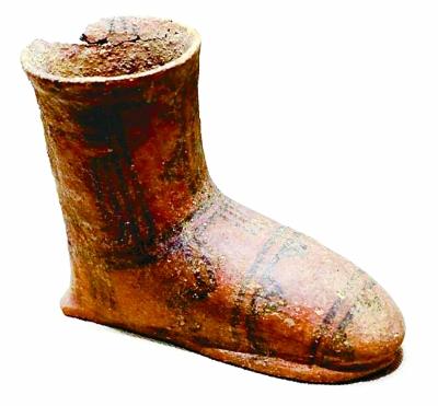 古老时尚里的靴子和手套