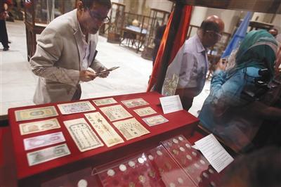 埃及首次向中国归还13件查获文物:含光绪年间银票