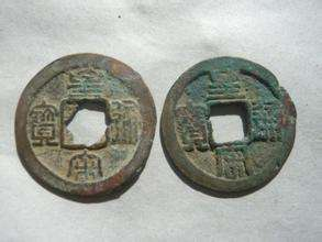 浅谈几枚古银币的历史背景