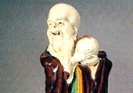 素三彩寿星捧桃瓷像