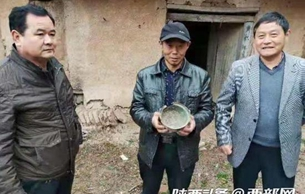 村民拓寬公路時發現古代文物 經鑒定為唐代銅釜